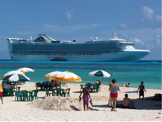 Luxury cruise ship near beach