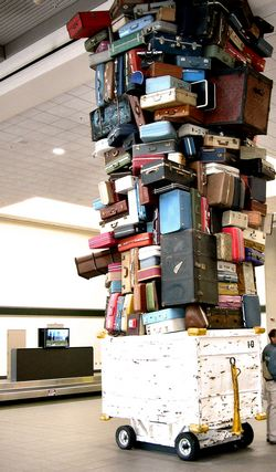 Towering pile of travel suitcases